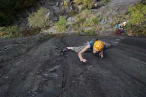 Hazel Robson with a determined look having made the crux step on Monsyter Kitten, E1 Dinorwic Slate.
