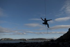 Ollie Cain lowers off the steep Muscle Beach, 8a at LPT. Great Ormes.