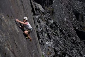 James Oswald edging his way up Off the Beaten Track. E3 5c. Australia, Dinorwic Quarries.