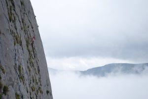 Jesse King climbing the amazing La Reunion, a three pitch 6a sports route on the Pena Cigal, Picos Du Europa.