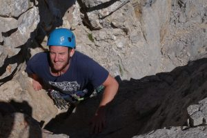 Josh Douglas climbing a Hard Severe limestone tower whilst being coach on his Trad Leading in the Picos Du Europa.