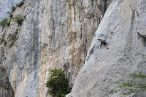 Josh Douglas climbing the technical Espolon Tima Turner 6b at Rumenes. Hermida Gorge, Picos Du Europa