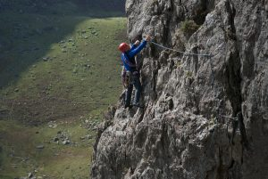 A climber traversing out acorss the classic Spiral Stair's, at VDiff this is one of the best easy routes in the Pass.