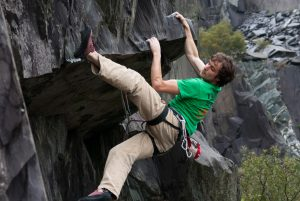 Finally a roof on slate rather than one made of Slate! pete Robin eases his way across Truffle Hunters Roof, F6c.