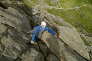 Guy Stevens, breaking through from the shade and into the sun on Lazarus, Severe on Idwal Slabs Hollytree Wall.
