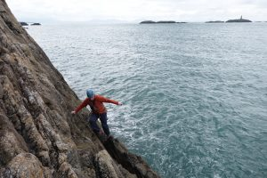 Simon Geering at the base of Sunset Slab Rhoscolyn