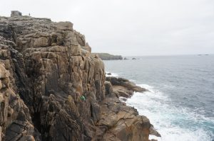 Rock Climbing on a grey day at Sennen Cove.