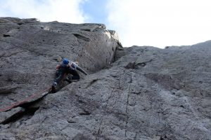 Tackling the hard start to Groove Above, a tricky severe on the continuation wall of Idwal Slabs