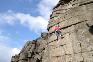 Getting used to the Grit at Stanage Egde during our Uk Trad Tour.