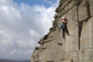 Climbing at the amazing Stanage Popular End on our UK Trad tour, learn the basic of grit climbing.