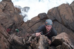 Enjoying easy trad climbing at Sennen Cove near Land's End Cornwall during our Uk trad tour