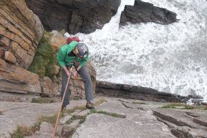 Abseiling into a lively Baggy Point