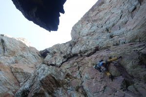 Simon Lake starting up the amazing Centrefold in fallen block zawn at Rhoscolyn.