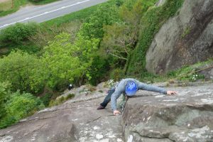 A client checking out his foot placement as he arrives at the final crux groove of Yogi on a lead climb coaching course.