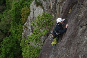 A client leading the top HVS pitch of Merlin Direct on a Lead Climbing Coaching weekend.