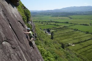 Ian Hey climbing scratch arete at Pant Ifan Tremadog.