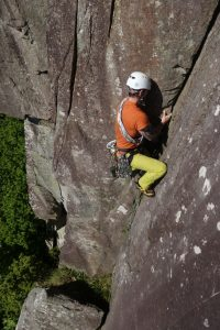 A client leading the stunning corner crack of Scratch pitch 2 on a lead climbing coaching course.