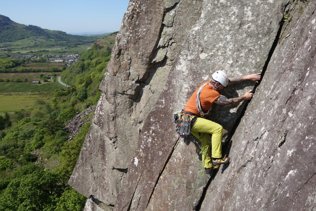 A client commits to the final lay backing section on the corner of Scratch, tremadog