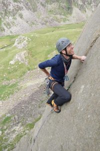 Adam pressing his way up the finger crack of The Link on Dinas Mot.