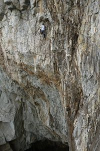 Adam showing us he has mastered trad climbing after a five day sort to trad conversion course, as he styles his way across the final pitch of A Dream of White Horses, Wen Zawn, Gogarth. We also offer guiding and coaching across this route.