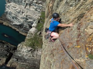 Mark Reeves Snowdonia Mountain Guides head coach on a day off enjoying Deygo, E3/4 Red Wall at Gogarth.