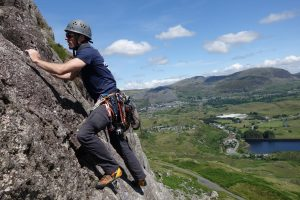 Alex climbing a classic easy route in the Meolwyns on his second day of a sport to trad climbing course