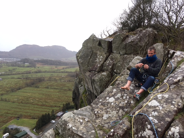 Matt Perrier sat on top of Christmas Curry after a fun wet ascent!