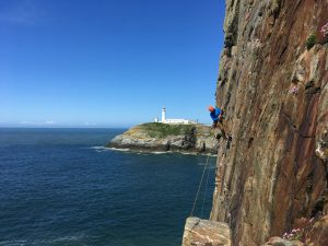 Abseiling into Castle Helen, Gogarth.