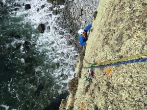 Simon Lake following a new route on Craig Dorys o the Llyn Peninsular