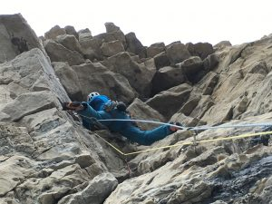 Simon on the top pitch of Mickey Mouse a wild and overhanging E3.