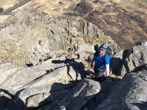One of our regular clients Simon heading up the North Tower of Tryfan.