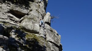 Emma leading up Needle Arete at the Dewerstone on a mini Trad tour.