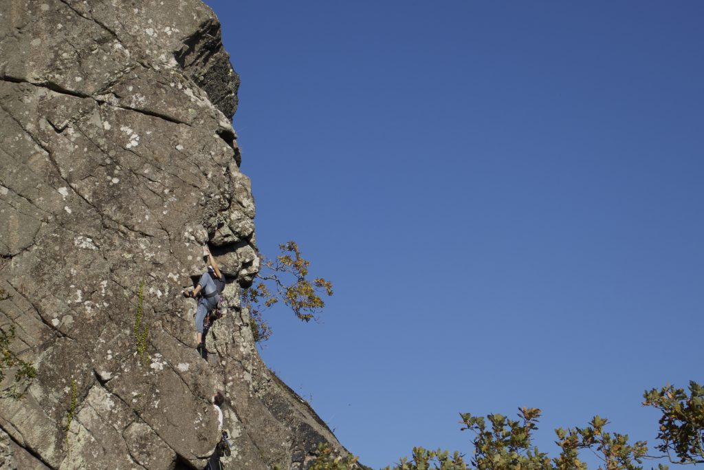 A climber in action on the Dewerstone, Devon.