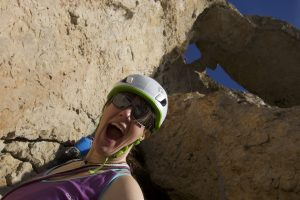 Tash loving the atmosphere after her 55m free hanging abseil into Parle, Toix Sea Cliffs
