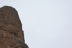 Some british climbers silloetted on the final aerate of Aguja Rojo, Riglos