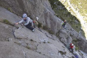 A climber heading up the second pitch of Charity on Idwal Slabs.
