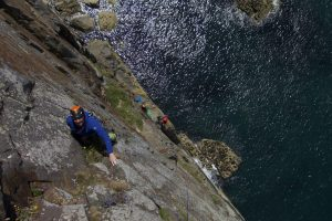 Adam Harmer on the class Rap at Castell Helen, South Stack, Gogarti