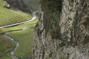 A climber charging u the initial flake system on King Wad, Scimitar Ridge, Llanberis Pass.