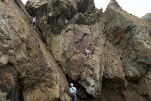 A busy Fallen Block Zawn at Rhoscolyn with climbers on Truant and the Absconder's Finish.