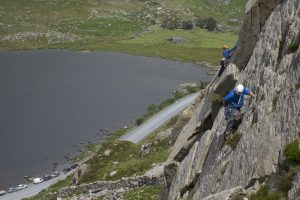 Climbers on the classic routes Rowan Route in the foreground and Super Direct in the background, on Milestone Buttress, Ogwen Valley.