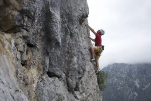 Warming up on a pleasant 6a at Cabadas in the Picos De Europa.