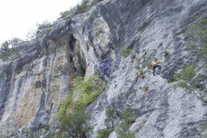 A climber enjoys the slab of Sector Camino, Ramales